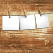 Background and white papers attach to rope with clothes pins — Stock Photo