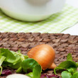 Onion and fresh herbs — Stock Photo