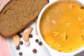 Soup with bread — Stock Photo