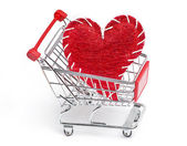 Shopping cart and red heart — Stock Photo