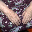 Stock Photo: Hands of an elderly woman