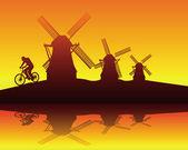 Molinos de viento y el jinete — Vector de stock