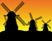 Three wind turbines — Stock Vector