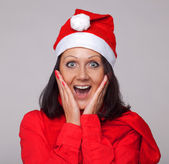 A beautiful girl dressed as Santa Claus — Stock Photo