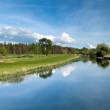 Royalty-Free Stock Photo: Idyllic golf course with reflection in the river