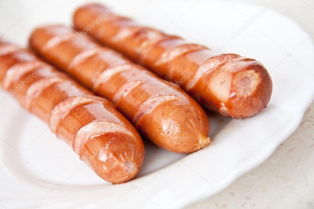 frankfurter worst hotdog eten op plaat stockfoto. Black Bedroom Furniture Sets. Home Design Ideas