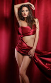 Sexy lady in red fabric — Stock Photo