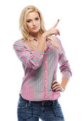 Nice blonde woman pointing at copyspace — Stock Photo