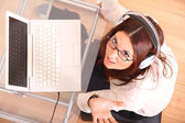 Laughing Woman with a Laptop and Headphones — Stock Photo
