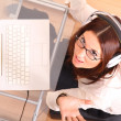 Laughing Woman with a Laptop and Headphones - Foto Stock