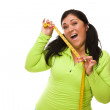 Hispanic Woman In Workout Clothes with Tape Measure — Stock Photo