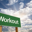 Workout Green Road Sign and Clouds - Stock Photo