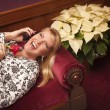 Laughing Blonde Woman on Purple Chair Using Cell Phone — Stock Photo