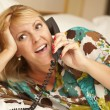 Woman Laying on Her Bed Using the Telephone — Stock Photo