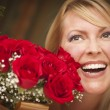Smiling Blonde Woman with Red Roses - Stock Photo