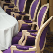 Foto de Stock  : Luxurious Purple Chairs in Formal Dining Room
