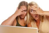 Two Shocked Women Using Laptop — Stock Photo