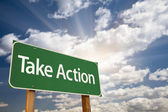 Take Action Green Road Sign and Clouds — Foto Stock