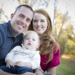 Young Attractive Parents and Child Portrait Outside - Stock Photo