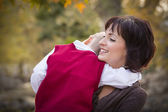 Attractive Mother and Son Portrait Outside — Stock Photo