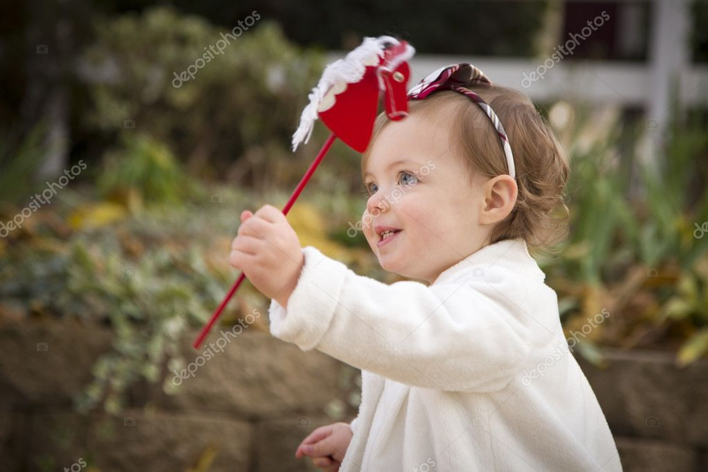 Adorable Baby Girl Playing Outside in the Park.  Stock Photo #8086251