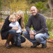 Young Attractive Parents and Child Portrait in Park - Stock Photo