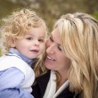 Attractive Mother and Son Portrait Outside - Stock Photo