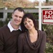 Happy Couple in Front of Real Estate Sign — Stock Photo