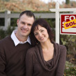 Happy Couple in Front of Sold Real Estate Sign — 图库照片