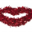 Lip Shaped Red Tinsel on White — Stock Photo