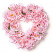 Heart Shaped Pink Rose Arrangement on White - Stockfoto