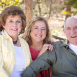 Senior Couple with Daughter in Park — Stock Photo #8963258