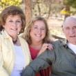 Senior Couple with Daughter in the Park - Stock Photo