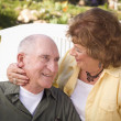 Royalty-Free Stock Photo: Senior Couple Kissing in the Park