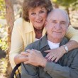 Senior Woman with Man Wearing Oxygen Tubes - Stock Photo