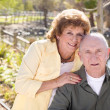 Stock Photo: Happy Senior Couple Relaxing in The Park