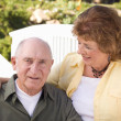 Happy Senior Couple Relaxing in The Park — Stock Photo #8963272