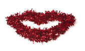 Lip Shaped Red Tinsel on White — Стоковое фото