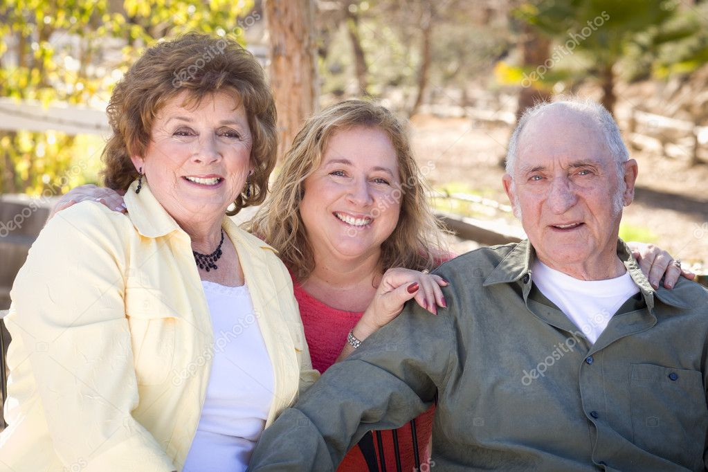 Portrait of Senior Couple with Daughter in the Park. — Stock Photo #8963258