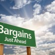 Stock Photo: Bargains Just Ahead Green Road Sign and Clouds