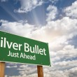 Silver Bullet Just Ahead Green Road Sign and Clouds — Stock Photo #8987816
