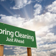 Royalty-Free Stock Photo: Spring Cleaning Just Ahead Green Road Sign and Clouds