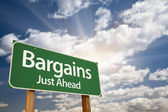 Bargains Just Ahead Green Road Sign and Clouds — Stock Photo