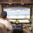 Couple Enjoy Beach View From RV - Stock Photo