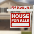 Stock Photo: Foreclosure House For Sale Sign and House