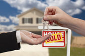 Handing Over the House Keys in Front of Sold New Home — Stock Photo