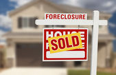 Sold Foreclosure Home For Sale Sign and House — Stock Photo