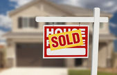 Sold Home For Sale Sign in Front of New House — Stock Photo