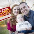 Happy Young Family in Front of Sold Real Estate Sign — Stock Photo