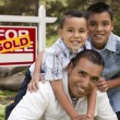 Hispanic Father and Sons in Front of Sold Real Estate Sign — Foto de Stock